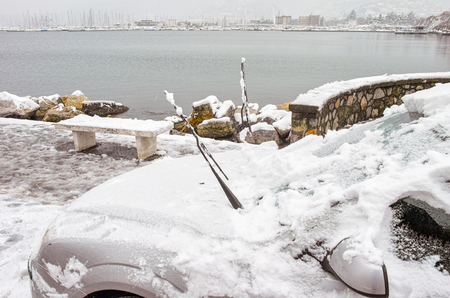 detail of car covered by snow in la spezia