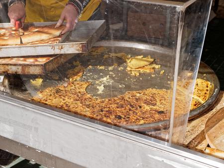 detail of ligurian farinata at market in italy