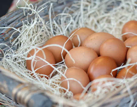 Chicken eggs in basket in a open market 스톡 콘텐츠