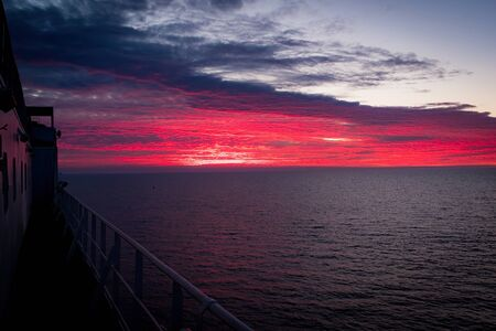 sunset at sea on board a merchant vessel during navigation in the ocean