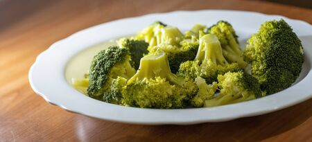 Steamed broccoli in a plate close up Stock Photo