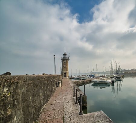 very nice view of harbour in peschiera del garda , italy