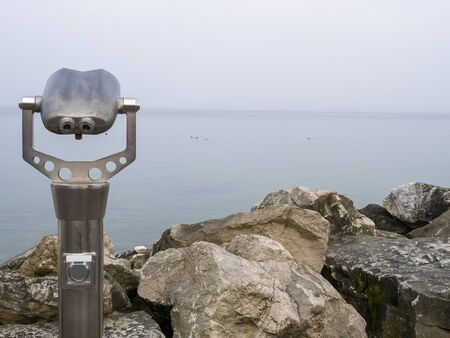 coin operated binoculars looking out in garda lake Banque d'images