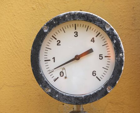 pressure gauge manometr on brown background