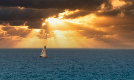 sailing boat during sunrise in front of deiva liguria , italy