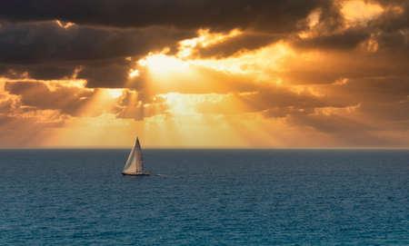 sailing boat during sunrise in front of deiva liguria , italy
