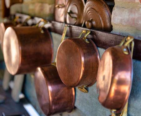 copper pot on a wall in a garden