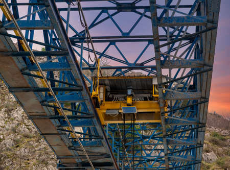 blue over head travelling crane in a marble factory