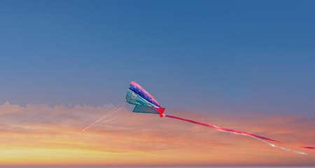 kite against sky during sunrise