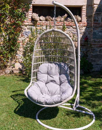 hammock chair in a summer garden Standard-Bild