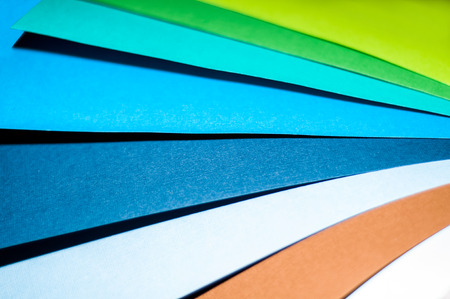 Multicolored paper. A stack of multi-colored papers Stock Photo