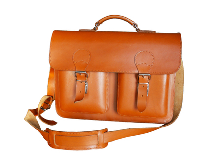 satchel: Vintage brown leather briefcase with strap and brass buckle Stock Photo