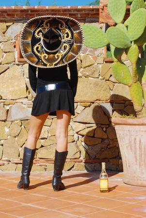 girl sombrero and bottle photo