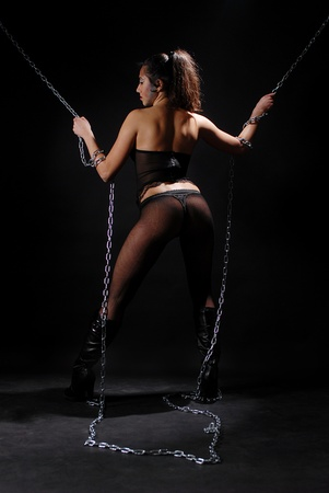 thong woman: girl in thong and lingerie chains Stock Photo