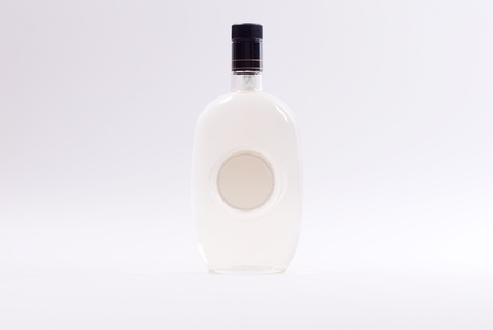 Isolated Grappa bottle on white background photo