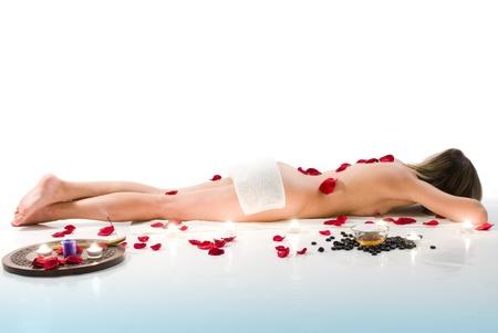 スパでリラックスできる白いタオルの女 写真素材