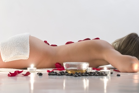 Woman in white towel relaxing in spa photo