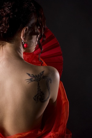 sexy woman from back with tatoo and red dress