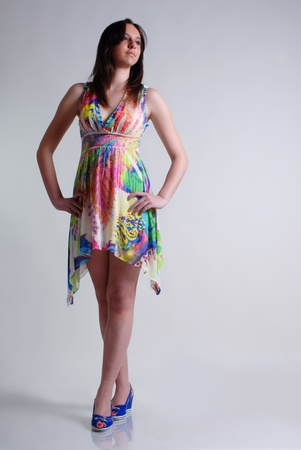 Isolated young woman colorfull dressed  photo