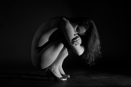 Isolated fine naked girl on black background Stock Photo