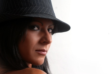 Brunette woman portrait with hat photo