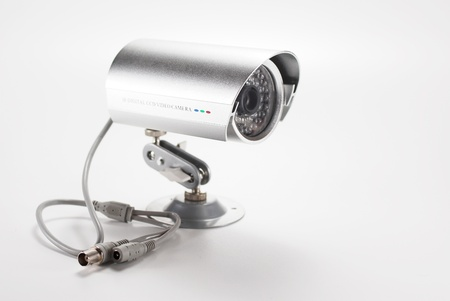 omnipresent: Silver isolated video surveillance camera Stock Photo