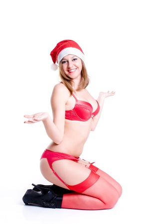 An isolated Christmas sexy woman smiling in red lingerie Stock Photo - 11596126