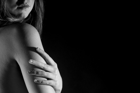 A sensual portrait from back in black and white on balck background Stock Photo - 11813426
