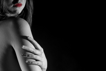 A sensual portrait from back in black and white on balck background Stock Photo - 11813425
