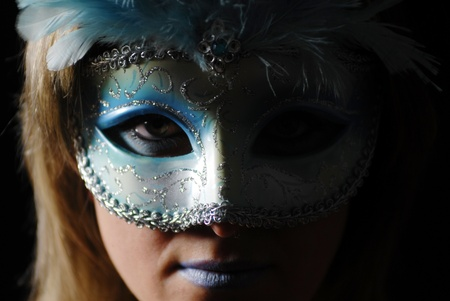 Detail of a face with carnival mask photo