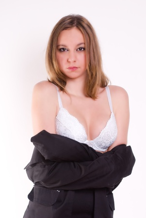 An isolated sexy secretary with a tailored shirt, on white background  photo
