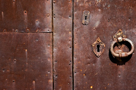 An ancient iron door texture with a lot of rust photo