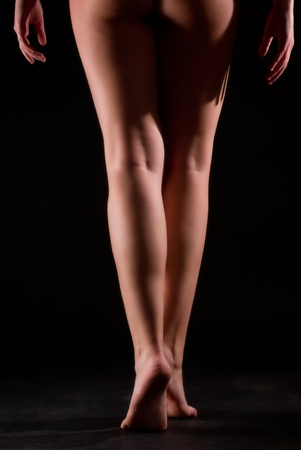 isolated dancer legs on black background