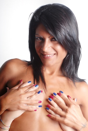 Happy girl covered with other hands and colored nails photo