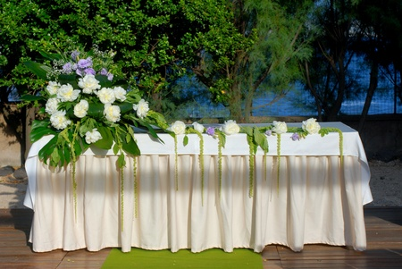 A wedding altar with flowers and plants photo