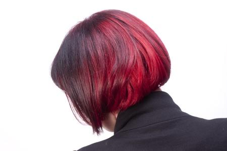 estilista: Chica con pelos cortos y agradables verdaderos rojos
