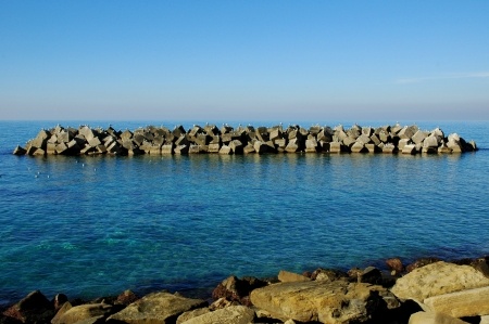 Sea landscape in Italy with roks in sunny day Stock Photo - 13679043