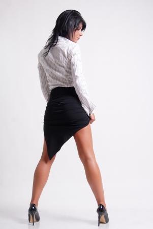 Sexy Business woman on white background Standard-Bild