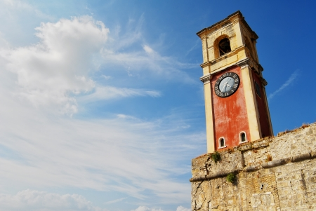 kerkyra: Red tower with big clock in Kerkyra, Greece.