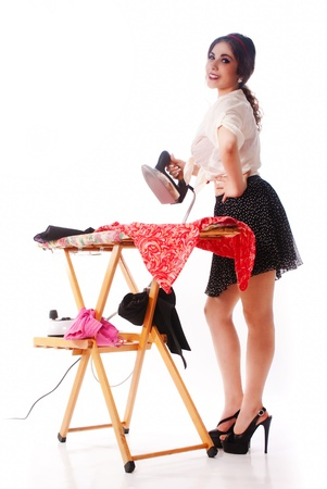 Nice, sexy and happy pin up girl ironing photo