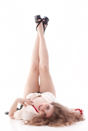 OSexy and young isolated pin up girl on white background photo
