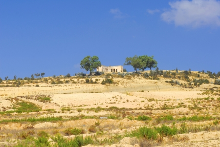 Landscape of arid Tunisian mountains with trees photo