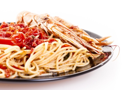 Isolated shoot of linguine with scampi on white background