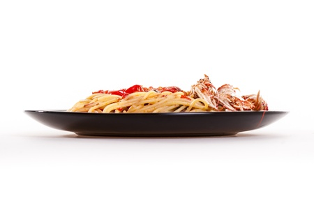 Isolated shoot of linguine with scampi on white background photo