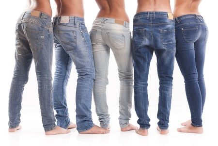 back light: Isolated group of young men and women with jeans