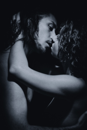 Black and white temptation woman and man, kissing photo