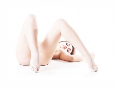 Isolated erotic naked woman on white background Stock Photo