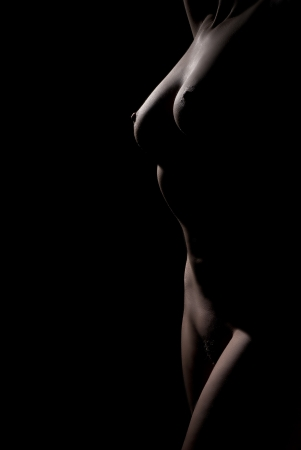Naked woman body scape on black background Stock Photo