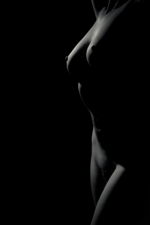 Black and white naked woman body scape on black background Stock Photo