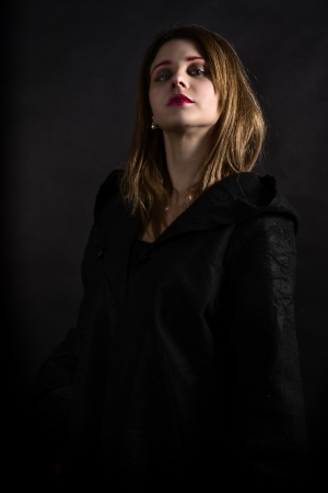priestess: Blonde gothic priestess in the dark Stock Photo